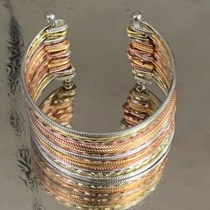Multi band cuff bracelet golds and silver accents